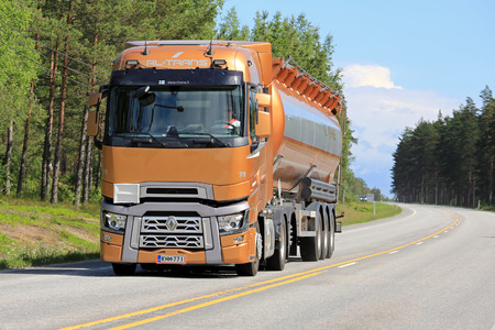 renault 5: RAASEPORI, FINLAND - JUNE 5, 2016: New orange Renault Trucks T semi tanker on the road  in South of Finland at summer.