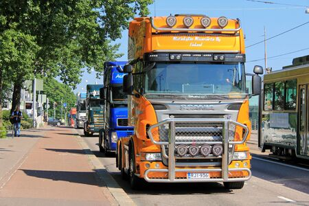 new rules: HELSINKI, FINLAND - JUNE 21, 2016: Group of Finnish truckers in convoy protest against the new EC Cabotage rules by the Finnish Parliament House in Helsinki.