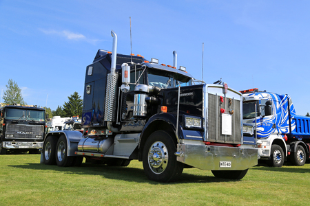 cummins: PORVOO, FINLAND - JULY 2, 2016: Dark blue Kenworth W900 truck tractor year 1982 on display on Riverside Truck Meeting 2016.