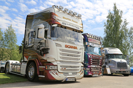 mack: PORVOO, FINLAND - JULY 2, 2016: Scania Streamline R25 (R450) of Martin Pakos 25 years on the road in a group of other show trucks on Riverside Truck Meeting 2016.