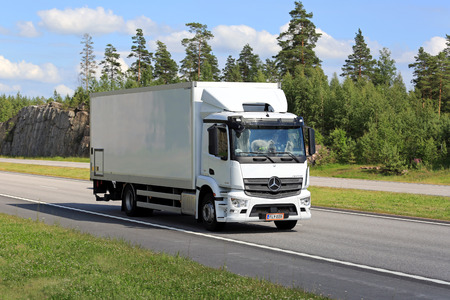 highway 6: PAIMIO, FINLAND - JULY 1, 2016: New white Mercedes-Benz Antos truck moves along motorway in South of Finland on a sunny day of summer. Editorial