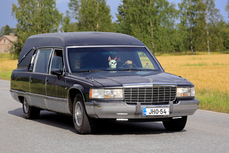 hearse: SOMERO, FINLAND - AUGUST 6, 2016: Cadillac Fleetwood funeral vehicle takes part in the 90 km Maisemaruise 2016 drive along scenic roads of Tawastia Proper, Finland in variable weather. Public event.