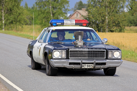 customized: SOMERO, FINLAND - AUGUST 6, 2016: Customized and modiified American Plymouth Police car takes part in the 90 km Maisemaruise 2016 drive along scenic roads of Tawastia Proper, Finland. Public event.