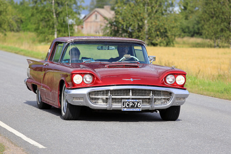 thunderbird: SOMERO, FINLAND - AUGUST 6, 2016: Red Thunderbird hardtop 1960 classic car takes part in the 90 km Maisemaruise 2016 drive along scenic roads of Tawastia Proper, Finland. Public event. Editorial