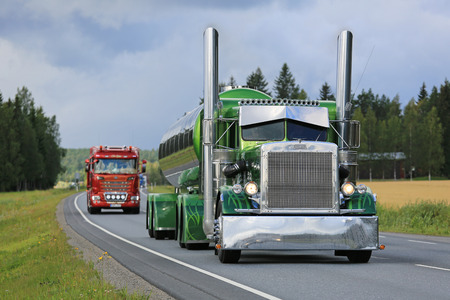 convoy: URJALA, FINLAND - AUGUST 11, 2016: Peterbilt 359 year 1971 of Fredrik Biehl moves along highway in convoy on the way to the annual trucking event Power Truck Show 2016 in Alaharma, Finland.