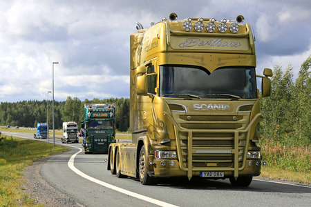 convoy: LEMPAALA, FINLAND - AUGUST 11, 2016: Berthons Scania Vikings V8 Longline 2016 moves along road as part of the truck convoy to the trucking event Power Truck Show 2016.