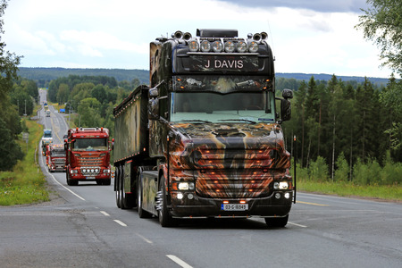 IKAALINEN, FINLAND - AUGUST 11, 2016: Customized Scania T580 Resident Evil of J Davis, Ireland moves along scenic road in truck convoy to Power Truck Show 2016 in Alaharma, Finland.