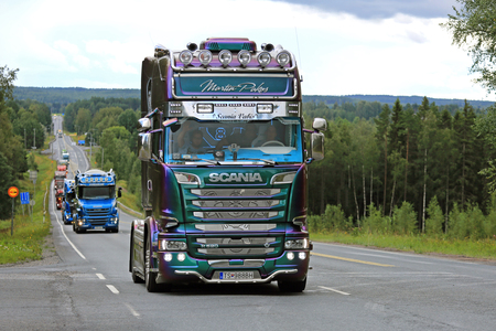convoy: IKAALINEN, FINLAND - AUGUST 11, 2016: Colorful Scania R520 of Martin Pakos takes part in the ca. 420 km long truck convoy from the ports of Helsinki and Naantali to Alaharma to the annual trucking event Power Truck Show 2016 in Alaharma, Finland. Editorial