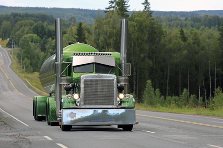 scenic highway: IKAALINEN, FINLAND - AUGUST 11, 2016: Peterbilt 359 year 1971 of Fredrik Biehl moves along scenic highway on the way to the annual trucking event Power Truck Show 2016 in Alaharma, Finland.