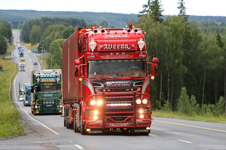 IKAALINEN, FINLAND - AUGUST 11, 2016: Red Scania R450 year 2016 Omerta of Weeda Transport from Holland takes part in truck convoy to the annual trucking event Power Truck Show 2016 in Alaharma, Finland.
