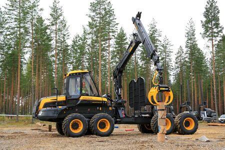 finalist: JAMSA, FINLAND - SEPTEMBER 2, 2016: Unidentified professional takes part in the National Forest Machine Operator Competition where great skill is required, held at FinnMETKO 2016.
