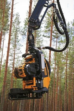 september 2: JAMSA, FINLAND - SEPTEMBER 2, 2016: Ponsse harvester head as seen on the Ponsse forest machinery work demonstration on FinnMETKO 2016.