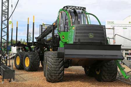 gatherer: JAMSA, FINLAND - SEPTEMBER 2, 2016: John Deere 1910G forwarder for big trees and long distances on display on the heavy machinery exhibition FinnMETKO 2016.