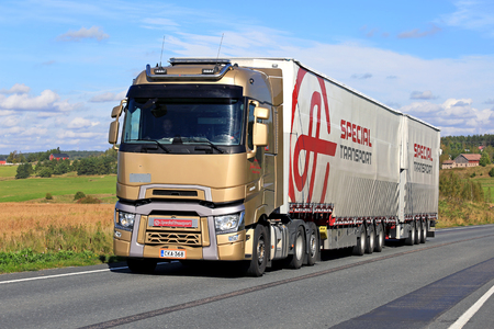 SALO, FINLAND - SEPTEMBER 11, 2016: Renault Trucks T and full trailer of Ahola Special Transport trucking along scenic road in South of Finland.