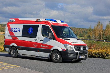 rushes: SALO, FINLAND - SEPTEMBER 18, 2016: Ambulance gets an emergency call and rushes ahead along road on a sunny autumn day in South of Finland. Editorial