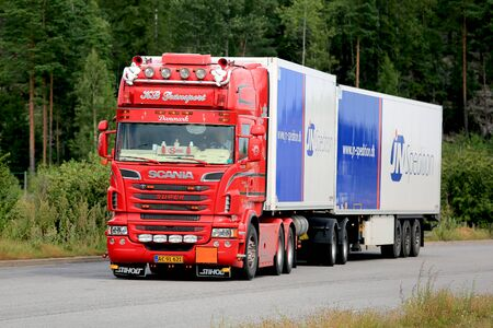 reefer: PAIMIO, FINLAND - AUGUST 5, 2016: Red customized super Scania refrigerated truck of KB Transport moving along road in South of Finland at summer. Editorial