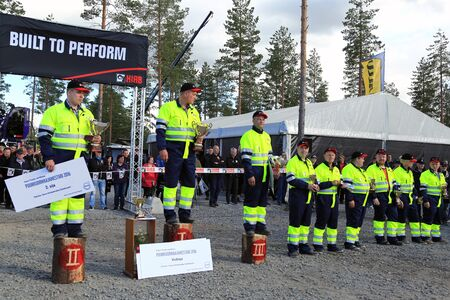 finalists: JAMSA, FINLAND - SEPTEMBER 2, 2016: Winner Jari Sarajarvi, 2nd left, with other finalists in the prize ceremony of the Finnish Championships in Log Loading 2016, held at FinnMETKO 2016.