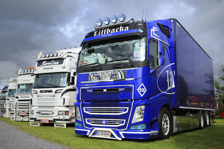 ALAHARMA, FINLAND - AUGUST 12, 2016: Blue Volvo FH Fierce Tiger of Lillbacka Logistics Oy in row of other show trucks on Power Truck Show 2016.