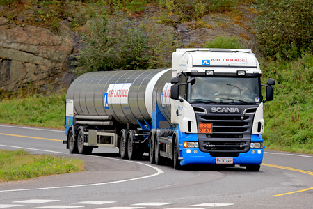 signifies: FORSSA, FINLAND - SEPTEMBER 4, 2016: Scania R500 tank truck of Air Liquide in ADR transport near road intersection. The ADR code 22-2187 signifies Carbon Dioxide, refrigerated liquid. Editorial