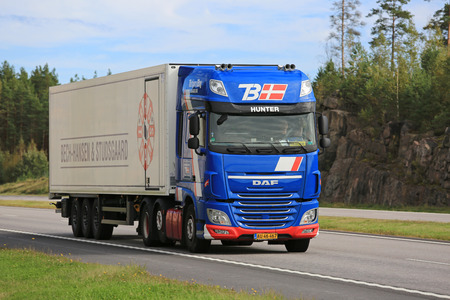 reefer: PAIMIO, FINLAND - SEPTEMBER 9, 2016: New blue DAF XF reefer truck of Torbjorn Bay moves along freeway in South of Finland. Editorial