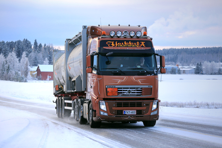 transport truck: SALO, FINLAND - JANUARY 16, 2016: Volvo FH silo transport truck moves along icy and snowy road in South of Finland in winter.