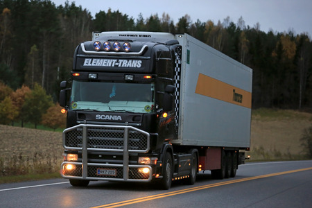 reefer: SALO, FINLAND - OCTOBER 16, 2016: Black Scania temperature controlled truck of Element Trans on highway in the evening. Refrigerated trucks can haul a variety of goods that require a climate-controlled handling. Editorial