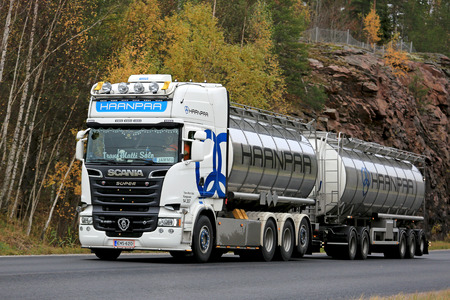 super highway: KARJAA, FINLAND - OCTOBER 15, 2016: White super Scania R620 tank truck of Trans Matti Salo for Haanpaa moves along highway in autumn in South of Finland.