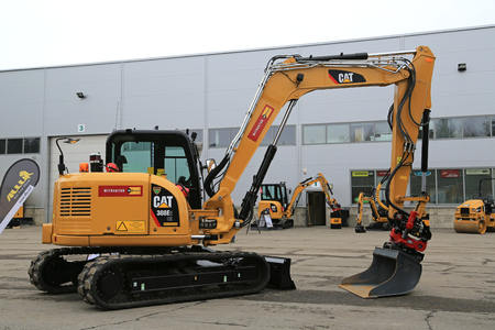 LIETO, FINLAND - MARCH 12, 2016: Cat 308E2 CR Mini Hydraulic Excavator with swing boom and other Cat construction equipment seen at the public event of Konekaupan Villi Lansi Machinery Sales.