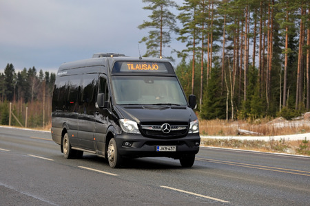 public transfer: LOUKKU, FINLAND - NOVEMBER 5, 2016: Black Mercedes-Benz minibus drives along highway in light early winter snowfall in South of Finland. Editorial