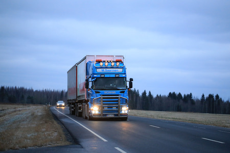 tl: KOSKI TL, FINLAND - NOVEMBER 5, 2016: Blue Scania R500 cargo trailer truck of Mikko Saarinen Ky on the road on a early winter evening.