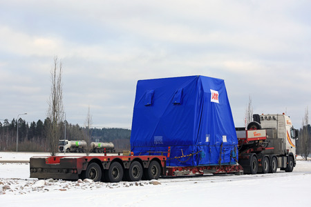 oversize: FORSSA, FINLAND - NOVEMBER 12, 2016: Side view of Volvo FH16 semi trailer oversize load transport parked on truck stop in winter.