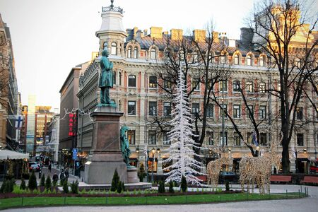 national poet: HELSINKI, FINLAND - DECEMBER 8, 2016: Statue of the Finnish National Poet Johan Ludvig Runeberg on Esplanadi Park among Christmas decorations in Helsinki, Finland.
