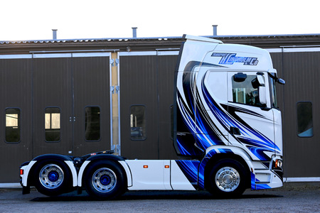 next year: RASEBORG, FINLAND - NOVEMBER 19, 2016: Side view of the next Generation Scania S500 of Transport K Lindholm & Co. with beautiful pinstripe design.
