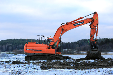 salo: SALO, FINLAND - NOVEMBER 27, 2016: Doosan DX255LC Medium Crawler Excavator at work in the road construction project on a winter day in Salo.