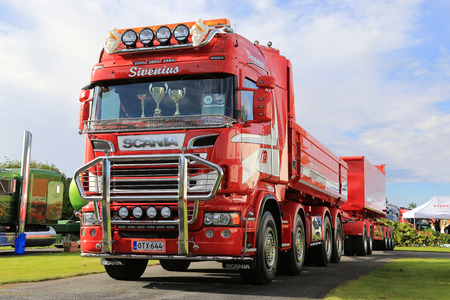 ALAHARMA, FINLAND - AUGUST 12, 2016: Scania R620 year 2014 truck and gravel trailers of Maanrakennus Sivenius Oy on display on the annual Power Truck Show 2016.