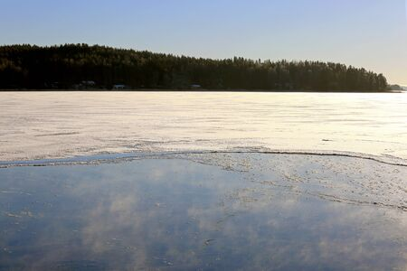 very cold: Vapor raises from freezing sea on a very cold and clear day of winter in Finland.