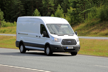 PAIMIO, FINLAND - JULY 8, 2017: White Ford Transit van moves along motorway at speed in summer. Editorial