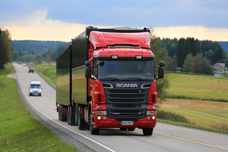 hauler: JAMSA, FINLAND - SEPTEMBER 1, 2016: Red Scania R560 combination vehicle drives along highway in the beautiful scenery of Central Finland. Editorial
