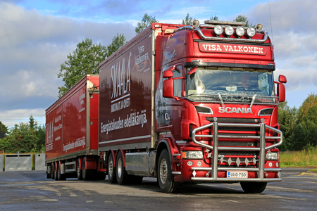 hauler: LAPUA, FINLAND - AUGUST 12, 2016: Red Scania R560 tractor trailer combination of Trans Harma Visa Valkonen, Finland parked on truck stop yard. Valkonen is a Finnish haulier known of customized heavy trucks.