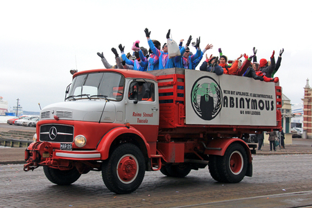 HELSINKI, FINLAND - FEBRUARY 16, 2017: Finnish 3rd year upper secondary school students celebrate the traditional Penkkarit by a ceremonial parade on decorated lorries across the city and throw candy at passers-by.