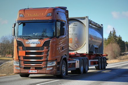 hauler: SALO, FINLAND - MARCH 17, 2017: Next Generation Scania S730 of Heikkila for ADR chemical transport trucking along highway at spring in South of Finland.
