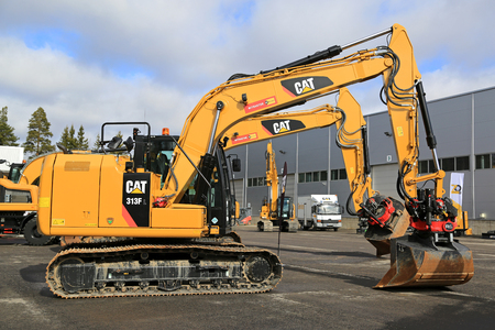 LIETO, FINLAND - MARCH 25, 2017: Cat 313FL Hydraulic excavator and other Cat construction equipment seen at the annual public event of Konekaupan Villi Lansi Machinery Sales.
