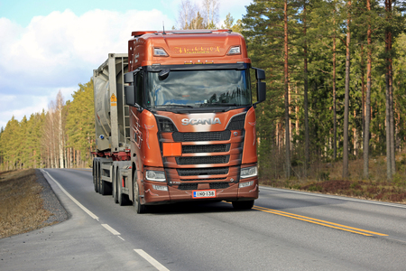 SALO, FINLAND - MARCH 24, 2017: Next Generation Scania S730 semi of Heikkila for ADR transport moves ahead on rural highway at spring.