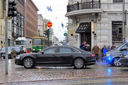 HELSINKI, FINLAND - APRIL 5, 2017: The President of China Xi Jinping and his delegation on the move with Audi A8 at rainy Market Square, Helsinki. Xi Jinping and his spouse Peng Liyuan visit Finland in April 5-6, 17. Editorial