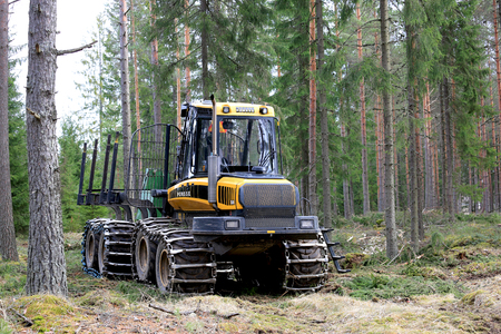 gatherer: HUMPPILA, FINLAND - APRIL 8, 2017: PONSSE Elk forest forwarder in coniferous forest at spring. The Elk has the load carrying capacity of 13 000 kg. Editorial