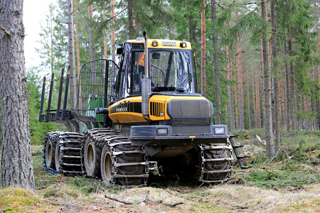 HUMPPILA, FINLAND - APRIL 9, 2017: PONSSE Elk forest forwarder in coniferous forest at spring. The Elk has the load carrying capacity of 13 000 kg. Editorial
