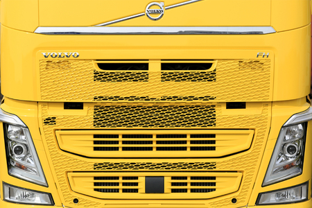 FORSSA, FINLAND - APRIL 9, 2017: Front of a new yellow Volvo FH truck, detail.