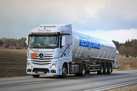 signifies: SALO, FINLAND - APRIL 13, 2017: Mercedes-Benz Actros semi tank truck for Eesti Gaas in ADR haul in Finland. The ADR code 223-1972 signifies methane refrigerated liquid or natural gas with high methane content.