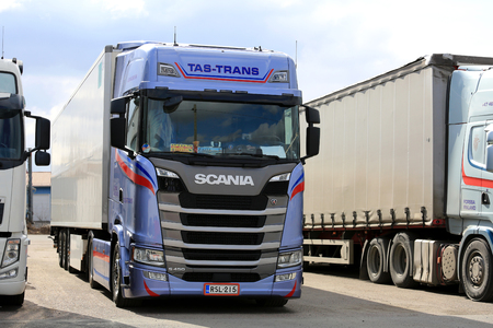 grille: FORSSA, FINLAND - APRIL 16, 2017: Next generation Scania S450 semi FRC trailer of Tas-Trans parked on an asphalt yard.