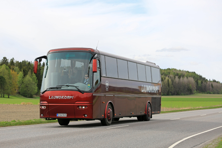 SALO, FINLAND - MAY 25, 2017: Red VDL Bova luxury coach bus of Launokorpi transports passengers along road at spring.